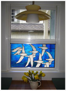 window with white birds on blue sky